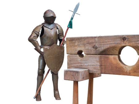 Knights armor with wooden pillory