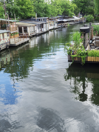 Simple wooden buildings on the banks of the flood ditch in Berlin-Kreuzberg.