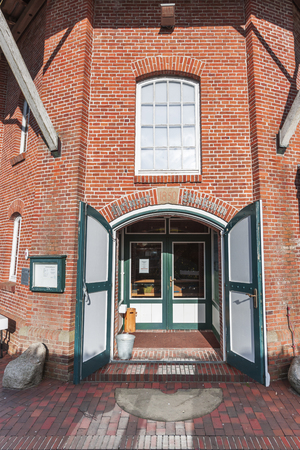 Wide angle view on the entrance to the Homeland Museum in the Pelde Mill in Esens.