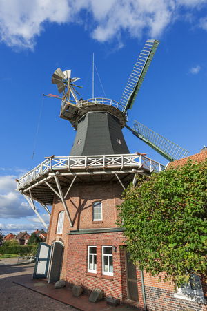 Wide angle view on the Pelde Mill in front of blue sky with small clouds. Redactioneel