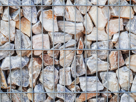 Full frame closeup of a rubble filled metal cage.