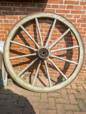 wooden wheel st the brick wall