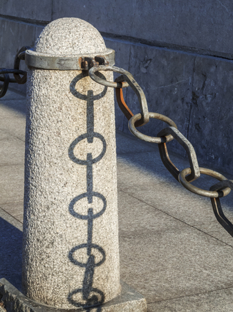 Chain at the pillar with shadow