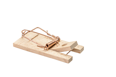 Small cocked wooden mousetrap isolated on white.