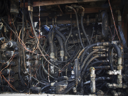 View into the hydraulic room of a burnt-out excavator.