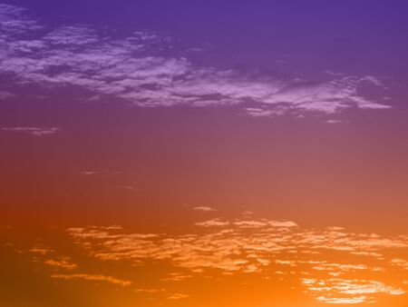 Sunset with scattered clouds and color overlay.
