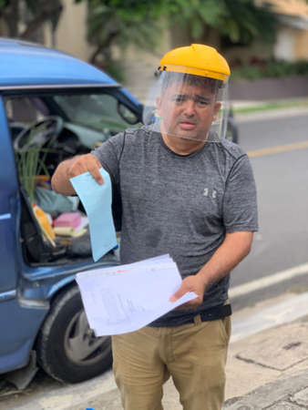 Escazu, San Jose, Costa Rica - May 2 2020:  Farmer showing circulation permits.  On his way to deliver he had a problem with authorities even though everything was ok so he was illustrating his stats.