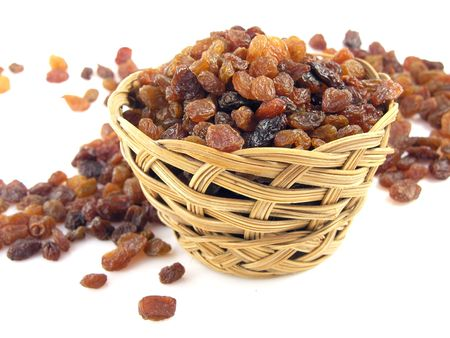 raisins on the white background in the basket