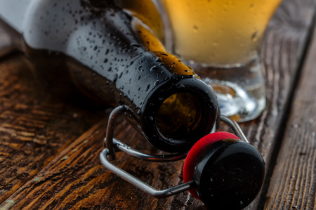 near beer: Empty bottle with glass beer. Close-up Stock Photo