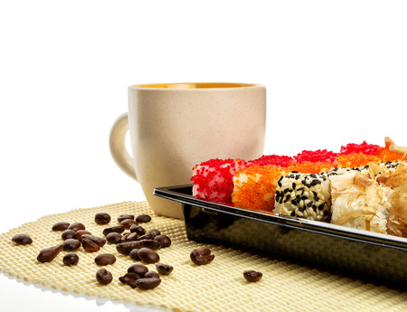 Sushi set in dark box with coffee cup and coffee beans. Isolated on white. Path included Stock Photo