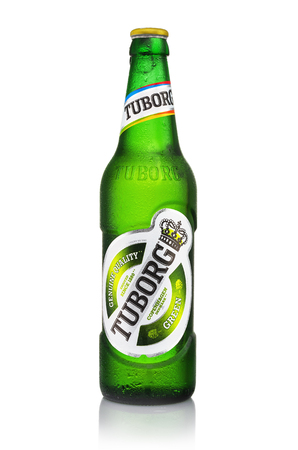 MINSK, BELARUS - AUGUST 23, 2016: Cold bottles of Tuborg Green Beer with drops isolated on white. Tuborg northern suburb of Copenhagen, Denmark. It has been part of Carlsberg Group since 1970