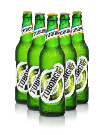MINSK, BELARUS - AUGUST 23, 2016: Five cold bottles of Tuborg Green Beer with drops isolated on white. Tuborg northern suburb of Copenhagen, Denmark. It has been part of Carlsberg Group since 1970