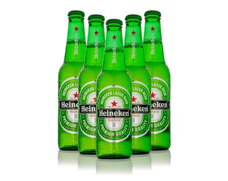 MINSK, BELARUS - DECEMBER 12, 2016: Cold bottles of Heineken Lager Beer with drops over white background. Heineken is the flagship product of Heineken International