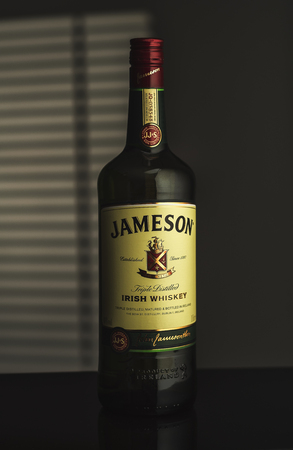 distillers: MINSK; BELARUS - AUGUST 26, 2016: Editorial photo of bottle of Jameson irish whiskey. Jameson is a blended Irish whiskey produced by the Irish Distillers subsidiary of Pernod Ricard. Editorial