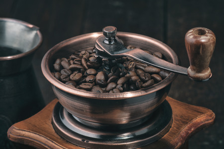 Close up handle coffee grinder with beans Stock Photo