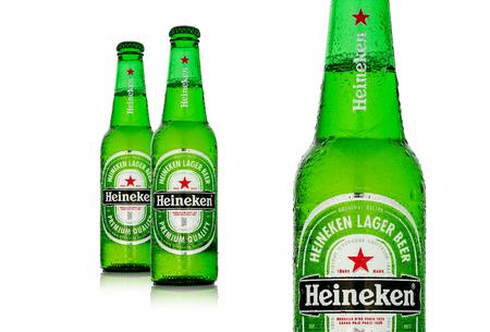 MINSK, BELARUS - DECEMBER 12, 2016: Editorial photo of cold bottles of Heineken Lager Beer with drops over white background. Heineken is the flagship product of Heineken International