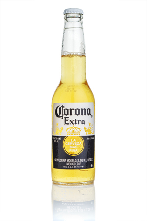 MINSK, BELARUS - JULY 10, 2017: bottle of Corona Extra beer isolated on white, one of the top-selling beers worldwide is a pale lager produced by Cerveceria Modelo in Mexico. Editorial
