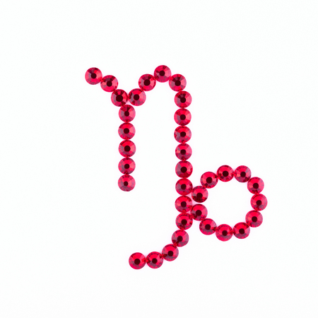 Capricorn. Sign of the zodiac of red rhinestones on a white background