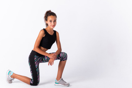 Young athletic girl isolated on white background.