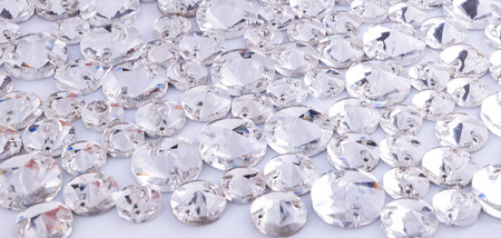 Many transparent sewn stones on a white background.
