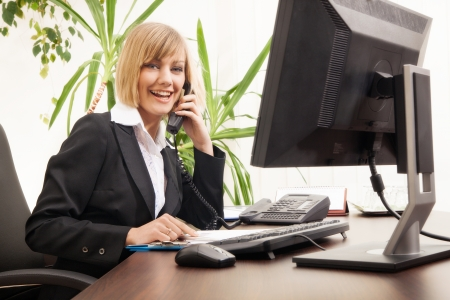 Female executive talking on phone in office Stock Photo