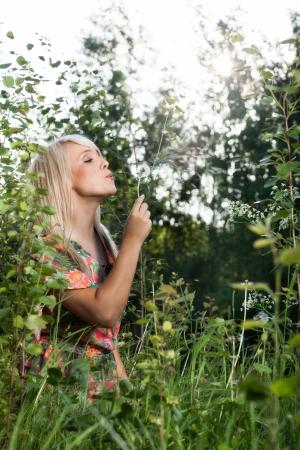 Young beautiful women in plants photo
