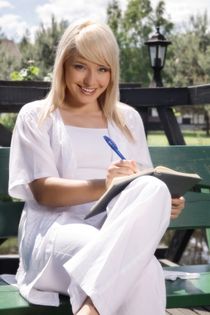 Beautiful young woman planning photo