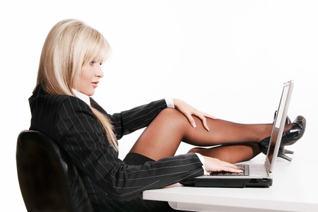 Beautiful young woman working with laptop Stock Photo - 19249356