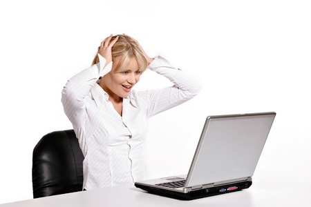 Beautiful young woman working with laptop Stock Photo - 19249336