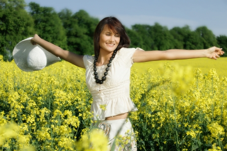 Young woman in the rape field photo