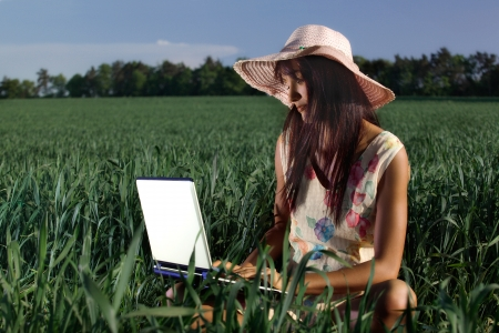 Young woman working with a laptop outdoor photo
