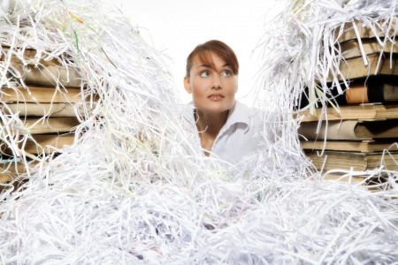 Young woman with shredded paper  Focus on face