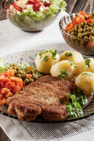 Breaded chop and potatoes  Dark light  Stock Photo - 19398903