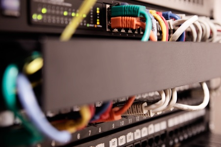 Network panel, switch and cable  Selective focus Stock Photo