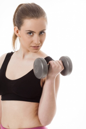 20 25: Beautiful sporty woman with dumbbells