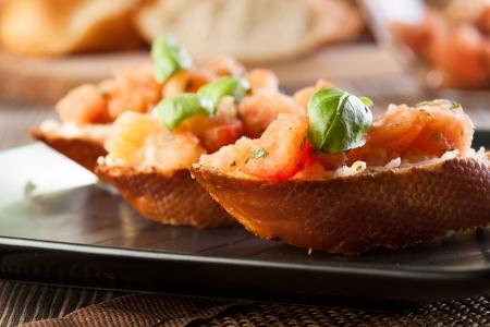Bruschetta with mozzarella and tomato  Selective focus Stock Photo - 20333997