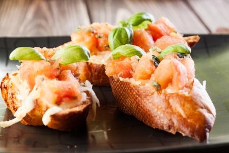 Bruschetta with mozzarella and tomato  Selective focus Stock Photo - 20334051