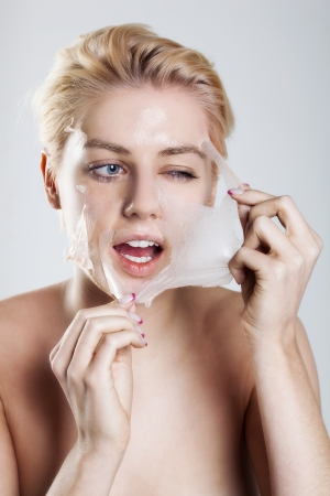 Beautiful woman cleaning her face Stock Photo