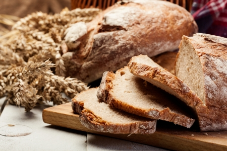 loaf of bread: Sliced rye bread on wooden table  Stock Photo