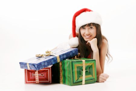 Young santa girl with gift boxes photo