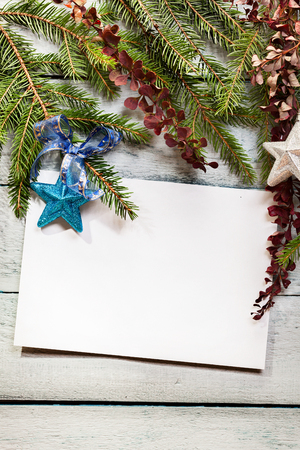 Christmas tree with decoration on a wooden board photo