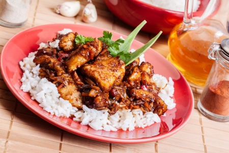 Sweet and sour pork and rice on a plate