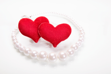 perls: Hearts and perls  Focus on hearts Stock Photo