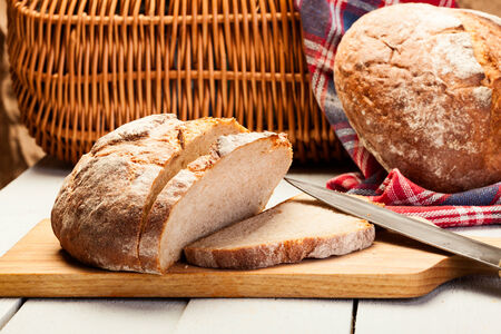 Sliced rye bread on wooden table  Stock Photo