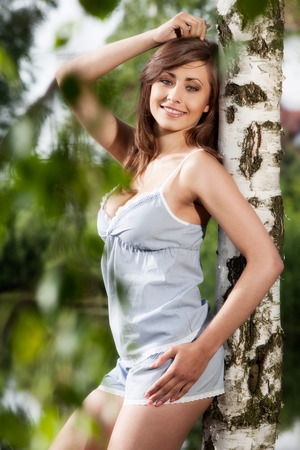 Pretty young girl relaxing in the park Stock Photo