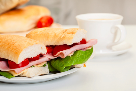 Italian panini sandwich with ham, cheese and tomato Stock Photo