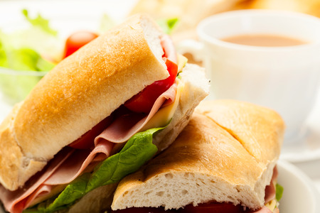 Italian panini sandwich with ham, cheese and tomato photo