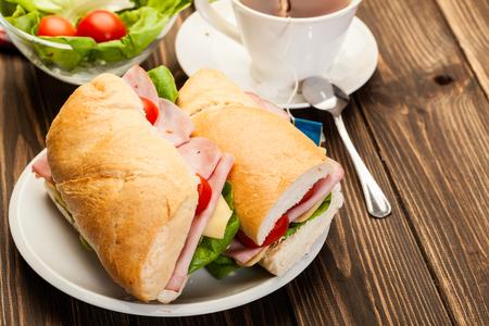 Italian panini sandwich with ham, cheese and tomato Stock Photo