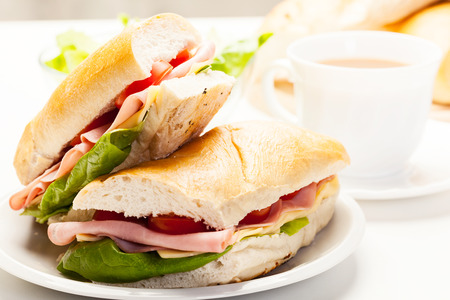 Italian panini sandwich with ham, cheese and tomato Standard-Bild