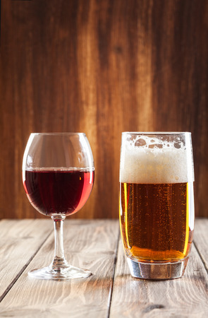 Red wine glass and glass of light beer Stock Photo